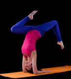 Woman exercise yoga asana - arm balance Stock Image