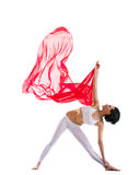 Woman exercise yoga asana and red flying fabric Stock Images