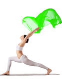 Woman exercise yoga pose with green flying veil Stock Photo