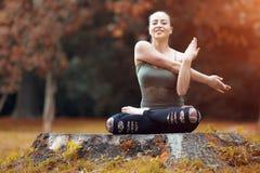 Woman exerciser in autumn park Stock Photos