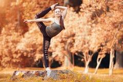 Woman exerciser in autumn park Royalty Free Stock Photo
