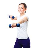 Woman exercises with dumbbells Royalty Free Stock Photo