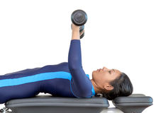 Woman exercises with dumbbells Stock Image