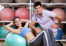 Woman exercises in fitness gym Royalty Free Stock Images