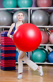 Woman exercises with gym ball Royalty Free Stock Photo