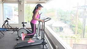 Woman exercises in a gym. Woman exercising on a treadmill at the gym stock footage
