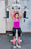 Woman exercises in a gym Stock Photo