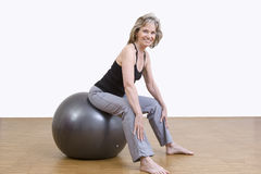 Woman exercises with pilates ball Royalty Free Stock Photo