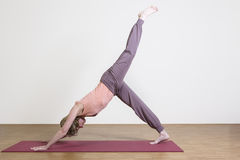 Woman exercises yoga Stock Images