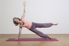 Woman exercises yoga Royalty Free Stock Image
