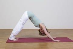 Woman exercises yoga Stock Photos