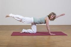 Woman exercises yoga Stock Photo