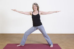 Woman exercises yoga Stock Photo