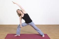 Woman exercises yoga Royalty Free Stock Photography