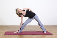 Woman exercises yoga Royalty Free Stock Photo