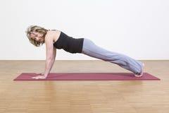 Woman exercises yoga Royalty Free Stock Photo
