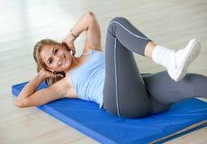 Woman exercising Stock Photography