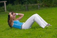 Woman exercising. Young healthy woman exercising outdoor Royalty Free Stock Photos