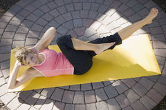 Woman exercising Royalty Free Stock Images