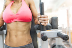 Woman exercising abdomen in the gym. Focus is on the hand Stock Image