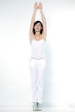 Woman exercising aerobics stretching arms tiptoe Stock Photos