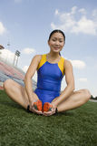 Woman Exercising On Athletic Field Stock Photo