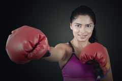 Woman exercising with attack style Royalty Free Stock Image