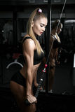 Woman Exercising Back On Machine In The Gym Royalty Free Stock Image