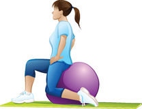 Woman Exercising On A Ball Stock Photography