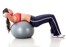 Woman exercising with ball Stock Photography