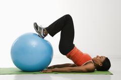Woman exercising with ball. Stock Image