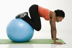 Woman exercising with ball. Royalty Free Stock Image