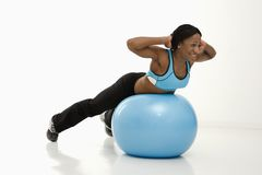Woman exercising with ball. Royalty Free Stock Photography