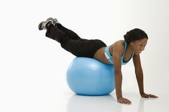 Woman exercising with ball. Royalty Free Stock Images