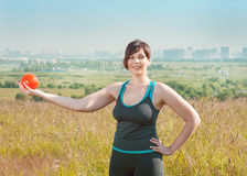 Woman exercising with ball Royalty Free Stock Photo