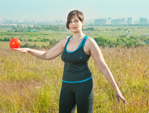Woman exercising with ball Stock Photo