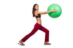 Woman exercising with ball isolated Royalty Free Stock Photos