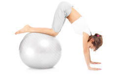 Woman exercising with a ball Stock Photos