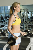 Woman Exercising With Barbell In Gym Royalty Free Stock Images