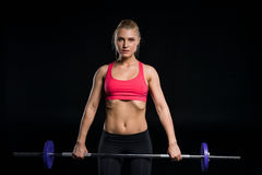 Woman exercising with barbell Royalty Free Stock Image