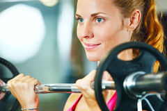 Woman exercising with barbell. Stock Photo