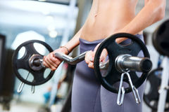 Woman exercising with barbell. Royalty Free Stock Photos