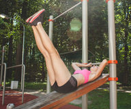 Woman exercising on bars Royalty Free Stock Photography