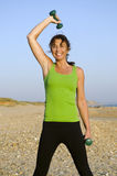 Woman exercising on beach. Royalty Free Stock Photography