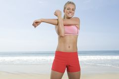 Woman Exercising At Beach Stock Photos