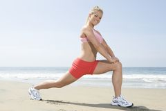 Woman Exercising On Beach Stock Image