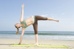 Woman Exercising On Beach Stock Images