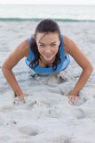 Woman exercising on the beach stock photos