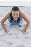Woman exercising on the beach Stock Photos