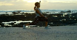 Woman exercising on beach at dusk 4k. Side view of woman exercising on beach at dusk 4k stock footage